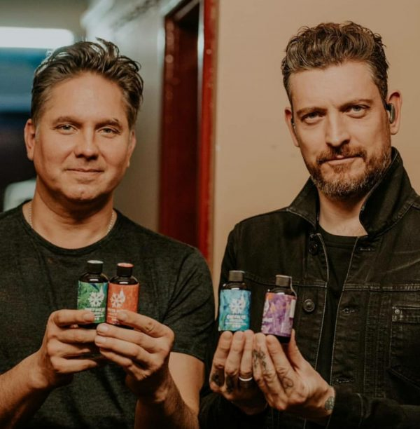 Jonny Quinn and Nathan Connolly Holding Snow Patrol Hot Sauce