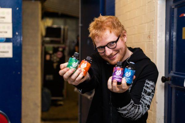 Ed Sheeran holding Snow Patrol Hot Sauce